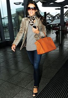 dress for first class - sharp blazer, scarf or light weight cashmere wrap, jeans or leggings, flats, heels, or riding boots