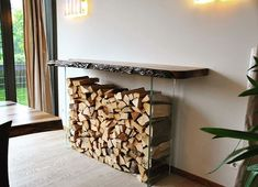 Nice idea to store firewood: between to sheets of safety glass and a live edge slab on the top, that serves a a sideboard. #walnut #wood #idea #firewood #storage #pile #interior #diy #homemade #live #edge#gonuts #in #bavaria #kuletische #nussbaum #walnut #walnutwood