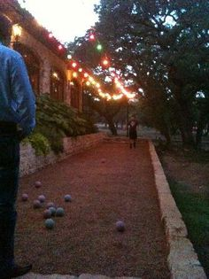 Bocce Ball Court... or you could ad a table for pong.. or anything... GAME AREA IN THE BACK YARD!! LOVE!