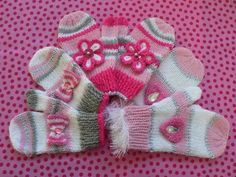 WINTER SPARKLE MITTS by Lorna Musk Quick to knit Winter mitts, with bow, flower & heart embellishments. Worked in oddments of DK, 4 ply metallic & ?fur? yarns (or equivalent). Instructions for four sizes to suit age range from 3 years to adult. For the samples shown in the photo, I used yarns with a lurex thread and, for the bow mitts, a silver metallic yarn (2 skeins of 4 ply being worked together). You could, of course, work the mitts in any combination of colours & stripes you prefer…