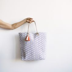 Blue, Navajo inspired brocaded tote bag pebbled leather handles and multi-colored tassel. Hand woven and sewn in Guatemala