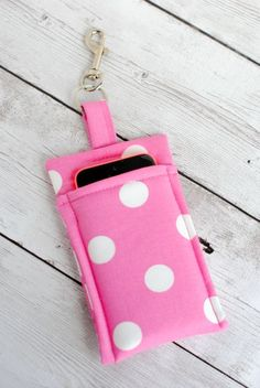Make this quick and Simple DIY Phone Wallet to carry your phone wherever you go. This tutorial is super simple and should take less than 30 minutes to complete. It's a great project for beginners! Make one of these cute phone cases with a few scraps of fabric and fusible fleece, and attach a clasp so you can clip it to your purse or key chain. If you've been looking for patterns for fabric phone cases, you'll love this adorable, pink, polka-dotted design! Get out your sewing machine and whip…