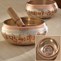 """Tibetan singing bowls from Nepal with 'Om Mani Padme Hum' on the outside, relief carving of Avalokiteshvara on the inside. 6"""" or 5 """" diam. Comes with wood striker."""