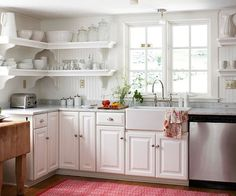 White-on-white kitchen. With a little kick of red.