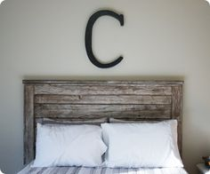 Brook from BeingBrook needed a headboard for her teenager's bedroom. She was going for a  rustic (on a budget!) look. All the headboards she found were expensive and out of her budget, so she found some great Ana White plans and was able to build a headboard for less than $40! She gave the wood an aged look with a steel wool and vinegar mix.