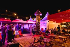 An evening shot of the Seventa Events summer 'pop-up' event on #Bournemouth beach
