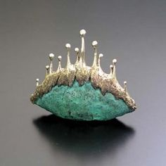 This one is pretty cool with the combination of the green and the silver, this picture comes from a Japanese art clay (Silver) website. (X)