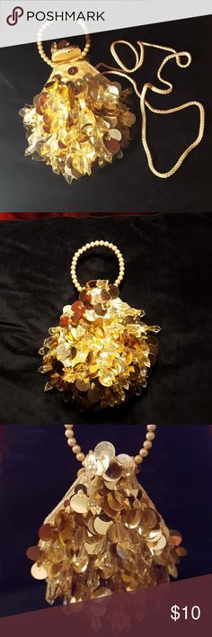 Small Sassy Mini Purse This is about the size of a DVD case.  Large gold sequins and crystal like beads, with faux pearl handle or you can use the strap.  Adorable!  Perfectly matched the mini gold dress in my closet. Bags Mini Bags