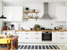 black and white kitchen with pops of color