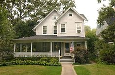 This is lovely: the doubled-up and offset facade, the assymetrical half-wrap porch. Right amount of windows to say northern temperate climate. On-axis straight shot walk from sidewalk to front door. American flag.