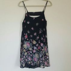 Cute Floral Print Dress Floral print dress. Spaghetti straps are NOT adjustable. Cute cut-out in back. This can be worn as a dress but it's a little short. Worn a handful of times. Smoke free home. Forever 21 Dresses Mini