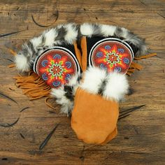 Astis Pocahontas Mitten (Women's) | Peter Glenn; Traditional native American hand craftsmanship meets modern technical design: hand-sewn from silicone-enhanced waterproof suede leather, decorated in vibrant beadwork, fur and leather tassles!