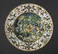 Plate: A Boar Hunt  Italy, Urbino; Atelier of the Fontana Family, 16th century    Date: c. 1560    Medium: tin-glazed earthenware (Maiolica)