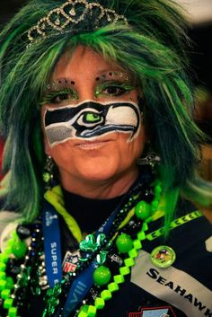 EAST RUTHERFORD, NJ - FEBRUARY 02: Seattle Seahawks fan with Seahawk painted on face attends Super Bowl XLVIII between the Denver Broncos and the Seattle Seahawks at MetLife Stadium on February 2, 2014 in East Rutherford, New Jersey. (Photo by Jamie Squire/Getty Images)