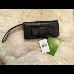 Kate Spade Mara Valencia Road Wallet/Wristlet New with tags- beautiful authentic Kate Spade wallet/Wristlet! Ostrich embossed cowhide with super cute bow on front. Eight credit card slots, center zip pocket for coins, one full length bill slip pocket, and two large expandable pockets. No trades! kate spade Bags