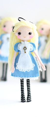 Alice in Wonderland art doll. Click on an image to be re-directed to the store.