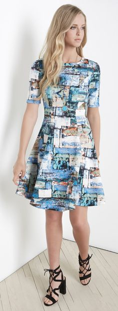 An abstract collage of colors and shapes give artsy appeal to a fit & flare dress that smooths and slims with its stretchy double-knit construction.