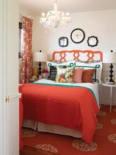 Coral Bedroom another with too many different elements, but I love the coral bedding, headboard & chandelier. I am surprised they don't have a more colorful one. TL