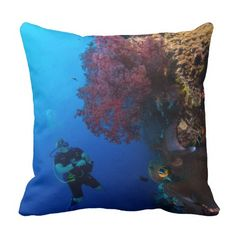 Throw Pillow featuring a diver admiring the beautiful vivid color of one of the soft corals found on Australia's Great Barrier Reef in the Coral Sea.