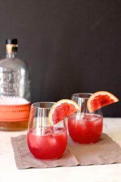 Blood Orange Bourbon Sour - Bourbon, Blood Orange Juice, Lemon or Lime Juice, Simple Syrup, Angostura Bitters, Blood Orange Slices for Garnish.