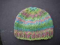 """Worked in super bulky yarn, this hat works up quickly and is nice and thick. It results in an 18"""" circ hat."""