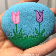 Thesetulip painted rocks are the perfect rock painting idea for spring! Learn how to draw a tulip while creating a rock that's perfect for hiding, gifting, or decorating!