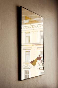 Mirrors opposite windows.