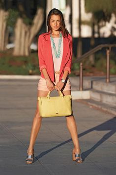 Love the juxtaposition of the chunky blue necklace against the sorbet colors of the outfit. Great shoes too.