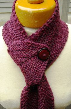 """My new design, """"One Way Scarf"""", why the name? Because the first thing my husband said when he saw the scarf laid out before attaching the button...""""it looks like a one way street sign"""". My own design and I have a pattern for sale for this scarf."""