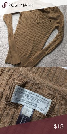 American Eagle cable knit sweater Camel colored cable knit v-neck sweater. Good used condition. Minimal polling under arms. Fits slim. Lightweight sweater. American Eagle Outfitters Sweaters V-Necks