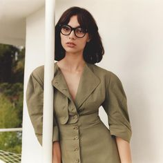 There's some silhouette reverb in our Summer collection, with corsetry inspired shapes in tonal khaki and intricate button detailing. Pair with our optical frames for a Summer statement.