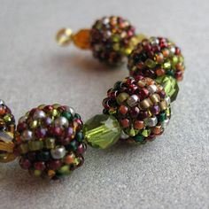 Handmade beaded beads in earthy colours. 12mm made from Japanese seed beads