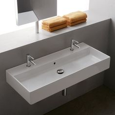 The Teorema Double Bathroom Sink features one basin with two faucet holes, breaking down barriers and allowing for unity in the modern bathroom. http://www.ybath.com/blog/building-a-modern-bathroom-for-two/ #YinTheWild