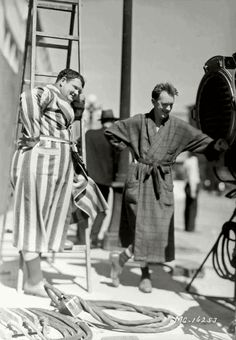 """A break on the set of """"One Good Turn"""" The boys watching a scene being filmed. 1931."""
