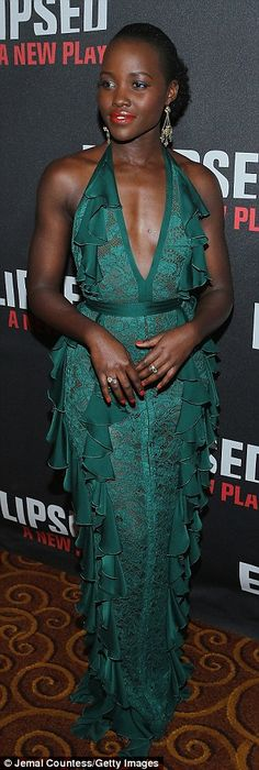 Taking the plunge! Stylist Micaela Erlanger dressed Lupita in an emerald lace, ruffled hal...