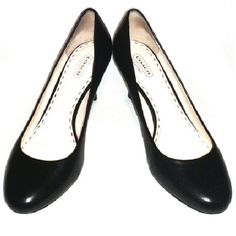 """REDUCED Coach Missy Black Leather Baby Doll Pumps Coach, babydoll-toes, low-cut vamps, & delicate heels between """"kitten"""" & """"spikes,"""" at 2 7/8"""" tall. 9 B. Insoles: 10.25"""" long & 3 1/8"""" across ball of foot. Uppers & stacked-leather heels are in most excellent condition, and feature a metallic-stud, Coach-signature logo on the outsides of the heel portion of the uppers. The pink insoles have slight indents from toes, but have been thoroughly cleaned. I wore these a couple of times. Without…"""