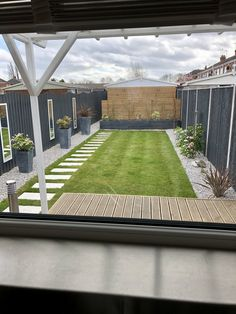 Garden make over complete . decked patio, gravel borders and raised bed , with planters, garden mirrors and water wall to add interest Small Backyard Gardens, Small Backyard Design, Backyard Patio Designs, Modern Backyard, Outdoor Gardens, Fence Landscaping, Small Backyard Landscaping, Garden Projects, Garden Ideas