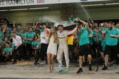 27.11.2016 - Race, Celebration, 2nd place Nico Rosberg (GER) Mercedes AMG F1 W07 Hybrid and Champion 2016 and Lewis Hamilton (GBR) Mercedes AMG F1 W07 Hybrid race winner