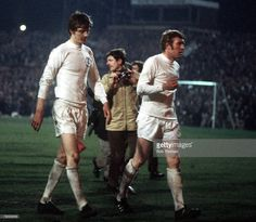 29th April, 1970. Dejected Allan Clarke and Mick Jones leave the field after some brutal play from winners Chelsea in the FA Cup Final Replay, Old Trafford,