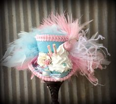 Pink and Blue Cupcake Mini Top Hat, Mad hatter Hat, Alice in Wonderland Hat, Tea Party Hat, Candy Land Mini Hat, Baby Shower hat by ChikiBird on Etsy https://www.etsy.com/listing/237115527/pink-and-blue-cupcake-mini-top-hat-mad