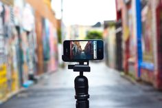 this little guy can be used with any regular tripod to mount your iphone and use as a video camera or camera. brilliant!