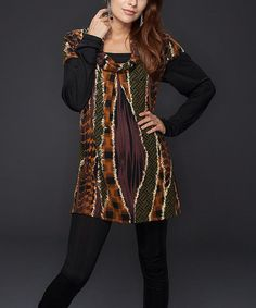 Never one to fade into the background, this tunic boasts a bold and artful blend of color and abstract patterns. With earthy tones and a distinct collar, it's sure to become a dynamic closet favorite. Measurements (size S): 31'' long from high point of shoulder to hem97% polyester / 3% spandexMachine wash; hang dry<...