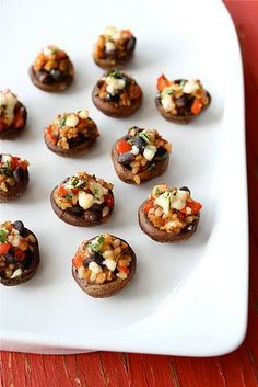 This Southwestern Stuffed Mushrooms #recipe with black beans, brown rice  red pepper is healthy and flavorful snack! Perfect to serve at #FourthofJuly celebrations this weekend!