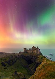 St. Patrick's Night Aurora danced above the Dunluce Castle in Northern Ireland on 17th March 2015