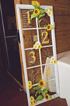 Wedding Reception Table Numbers Written on a Door