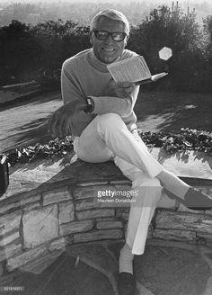 Actor Cary Grant (1904 - 1986) reading a book, circa 1980.
