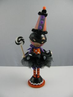 This Halloween doll has detailed skull and cross bone socks with purple accents. Her tulle skirt is the first Ive done and like it very much! The lollipop is courtesy of Dough & Batter of NY.