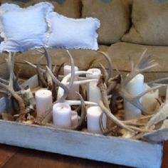 Antlers for the mantle, long box one row of candles