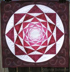 Insane Red Artichoke quilt by Sylvia Schaefer at Flying Parrot Quilts.  Pattern available at Craftsy
