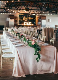 Jeremy Harwell; Belle of the Ball Events; Tara Keely gown; georgia wedding; atlanta wedding; southern wedding; Summerour Studio; feasting table with pale pink cloth; pink floral table runner; gold tiffany chairs with white cushions; string lights;